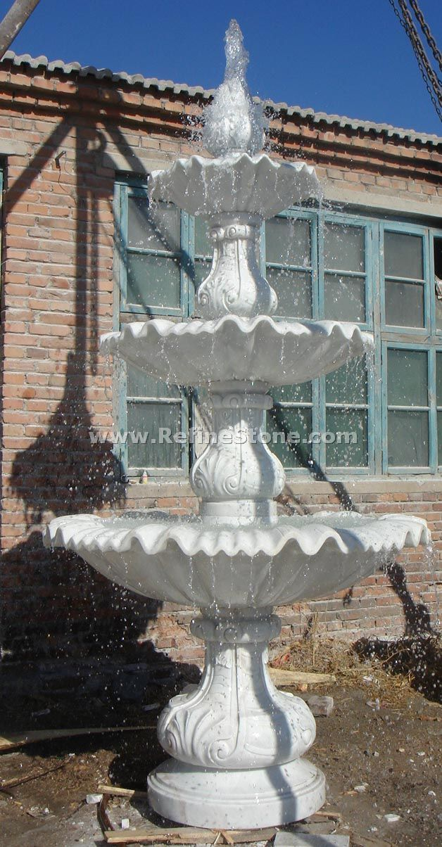 white marble fountain statue
