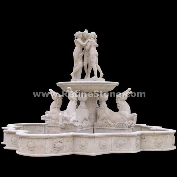 carved human and animal water fountain