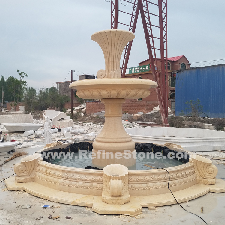 Gold yellow marble stone fountain